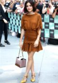 Lucy Hale wears a caramel dress at the AOL Build Series in New York City