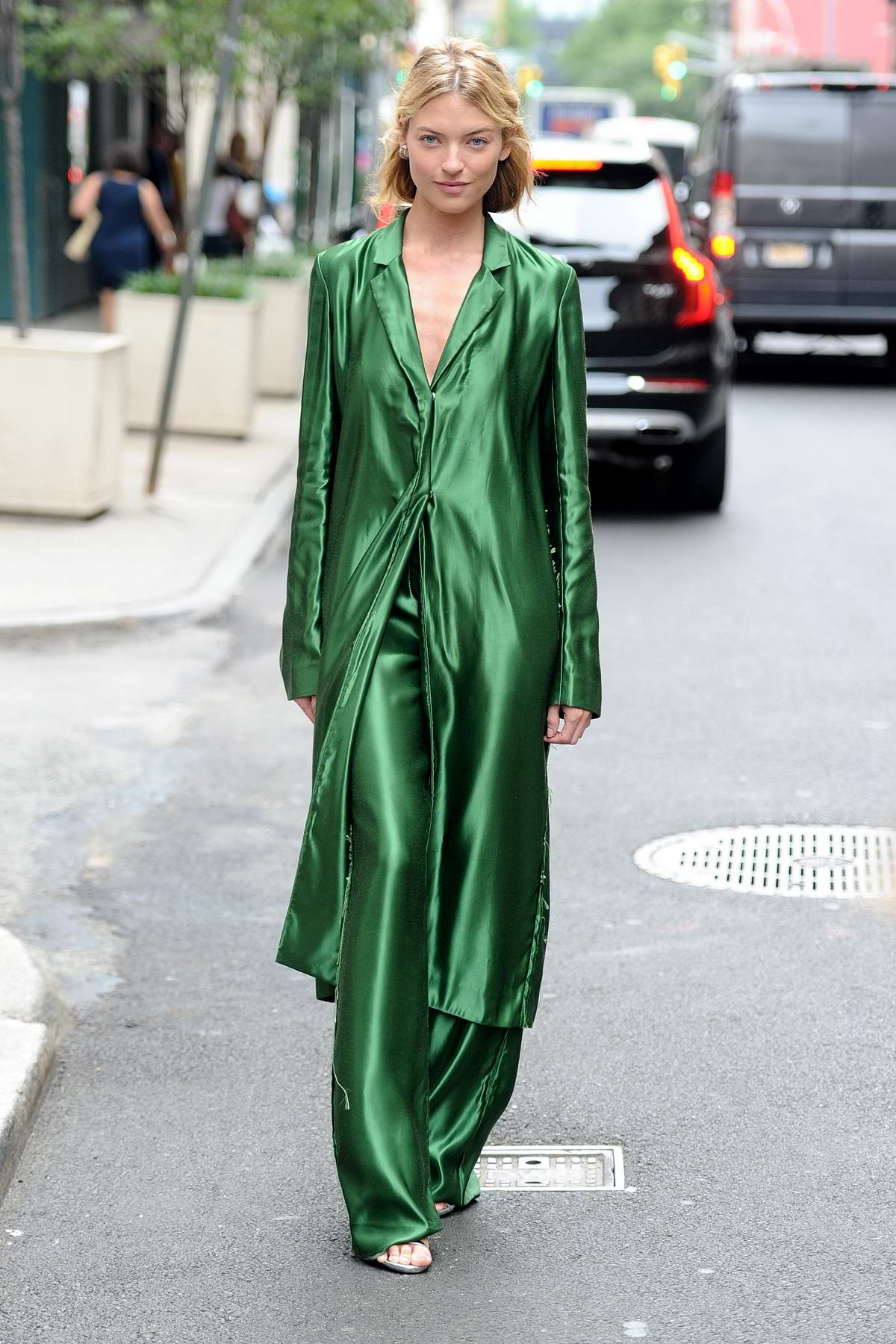 Martha Hunt seen wearing a green outfit as she heads out during New York Fashion Week in New York City