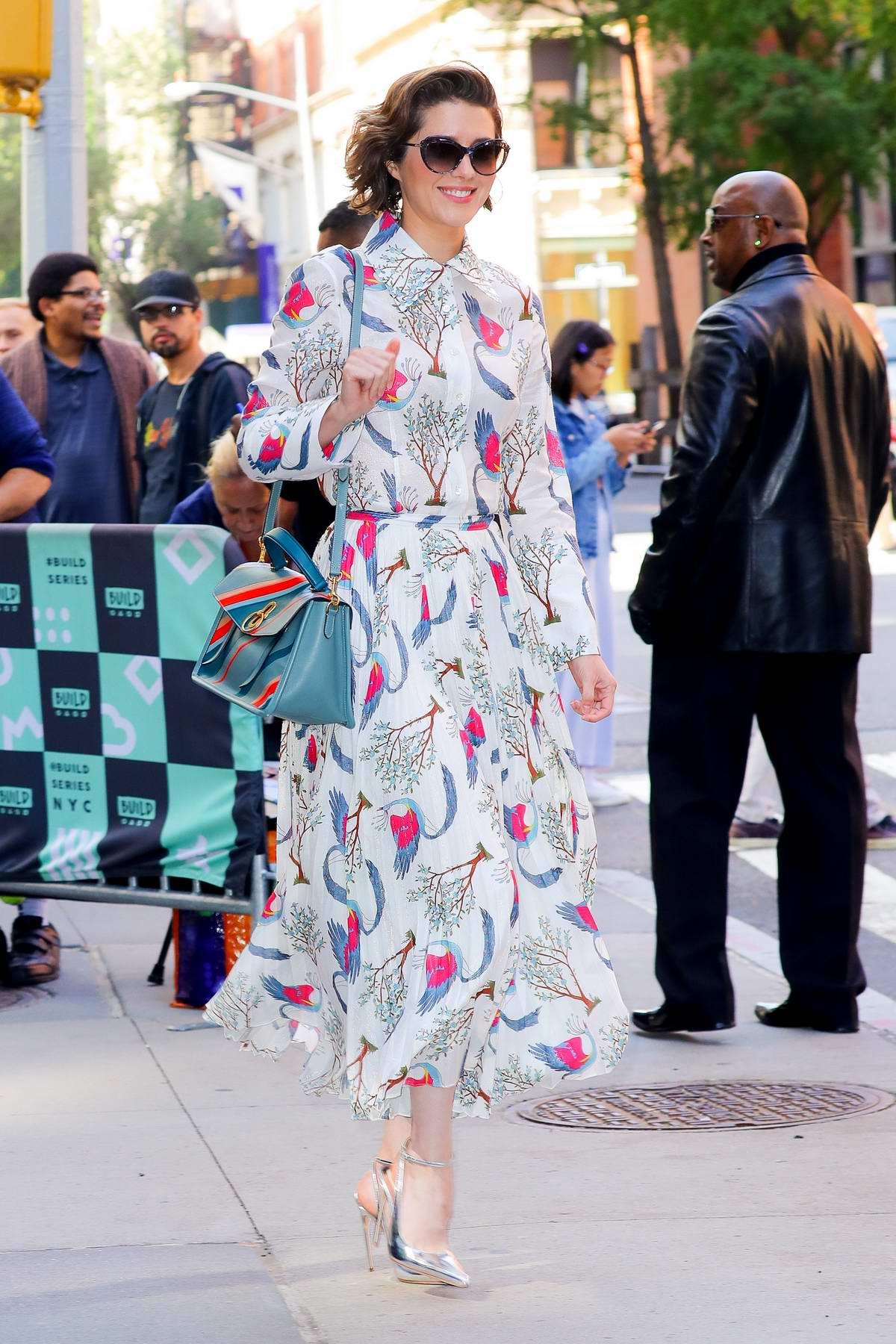 Mary Elizabeth Winstead spotted in a white and pink patterned dress outside the AOL Build Studios in New York City