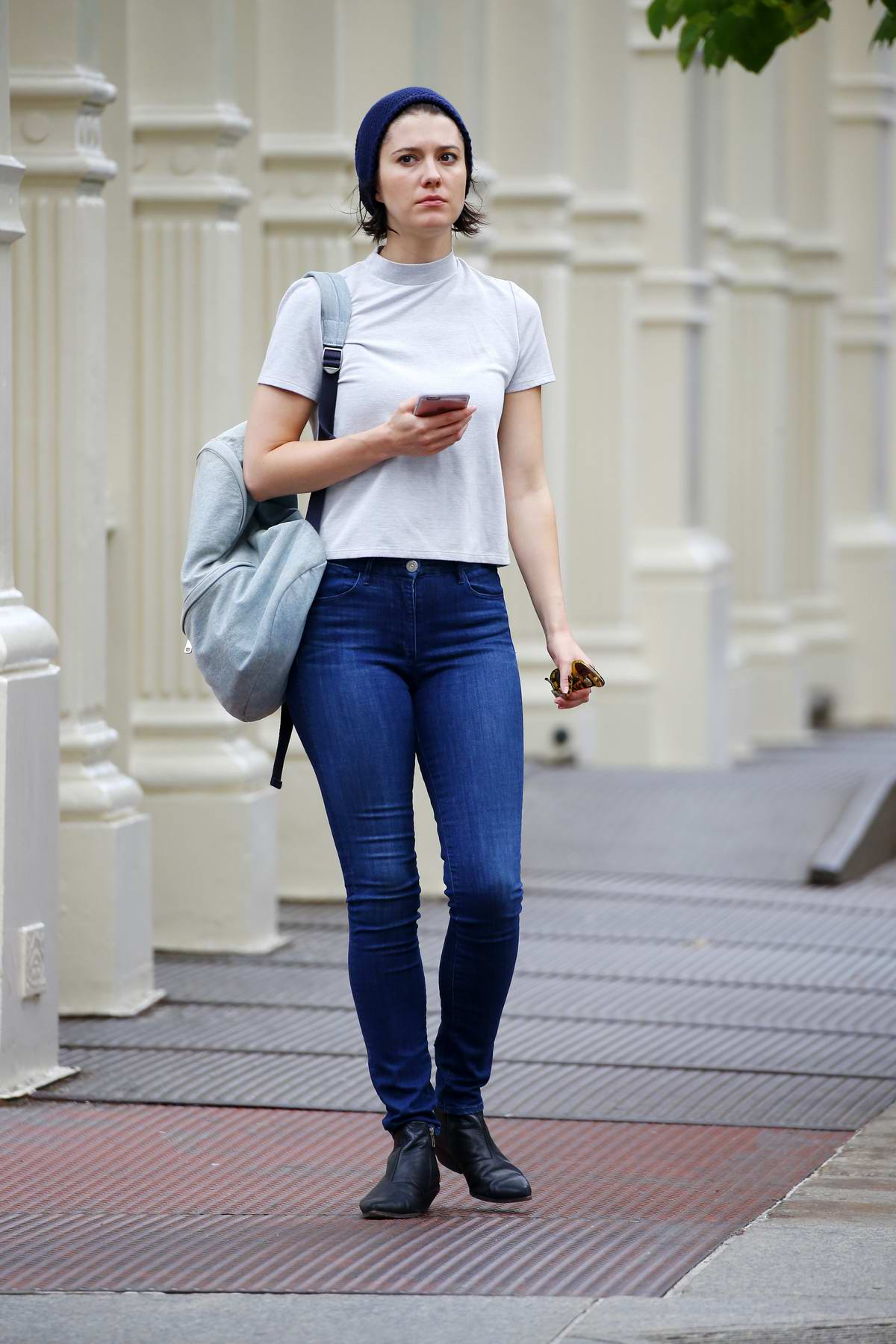 Mary Elizabeth Winstead wearing a white top and jeans with blue bonnet while out in Soho, New York City
