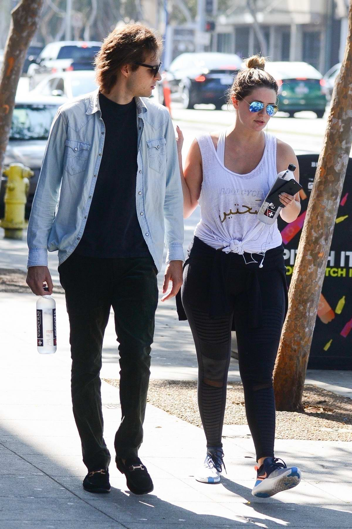 Mischa Barton spotted in white tank top and black leggings while out for walk with male friend in Los Angeles
