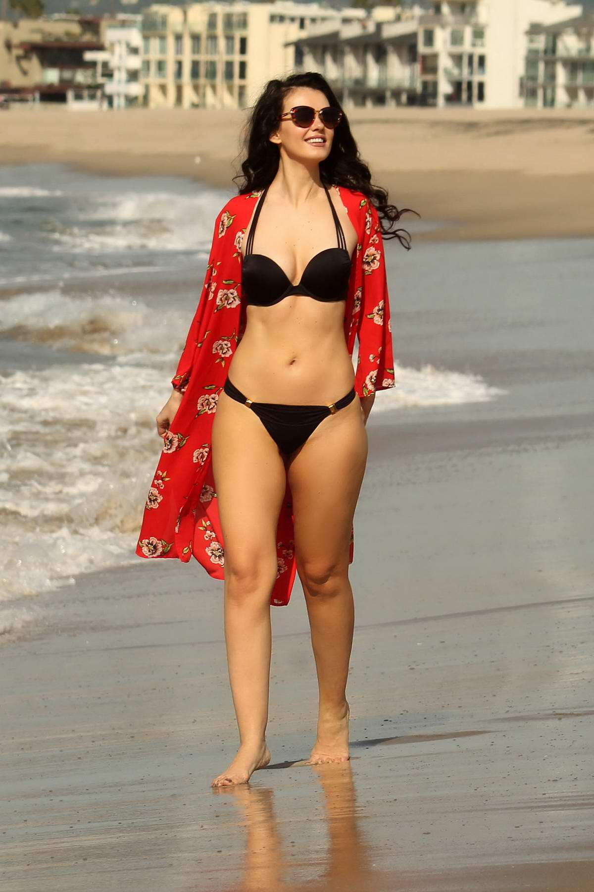 Natasha Blasick spotted in a black bikini while having fun on the beach in Malibu, California