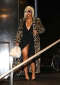 Nicki Minaj heads out in a leopard print fur and plunging dress during New York Fashion Week in New York City