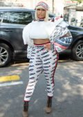 Nicki Minaj rocks an all Fendi ensemble as she arrives for the Fendi show during Milan Fashion Week in Milan, Italy