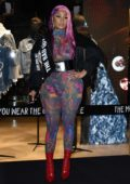 Nicki Minaj shows off her unique style in a colorful sheer jumpsuit as she attends at Store Diesel during Milan Fashion Week in Milan, Italy