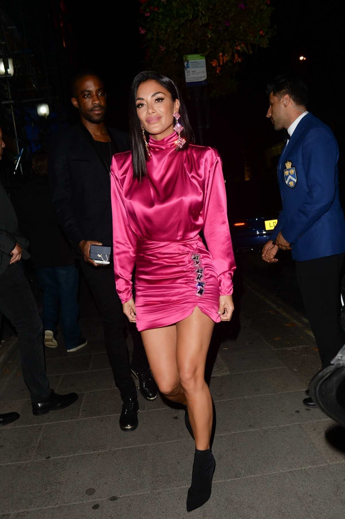 Nicole Scherzinger spotted in a pink outfit as she leaves Annabel's nightclub in London, UK