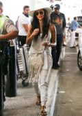 Nicole Scherzinger spotted in an all white ensemble as she touch down at LAX airport in Los Angeles