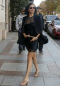 Nina Dobrev wears a black minidress as she steps out of the George V Hotel in Paris, France