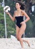 Nina Dobrev wore a black swimsuit while enjoying a game of beach volleyball with April Love Geary and Robin Thicke in Malibu, California
