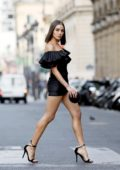 Olivia Culpo looks stunning in a short black dress with matching stilettos while out for stroll in Paris, France