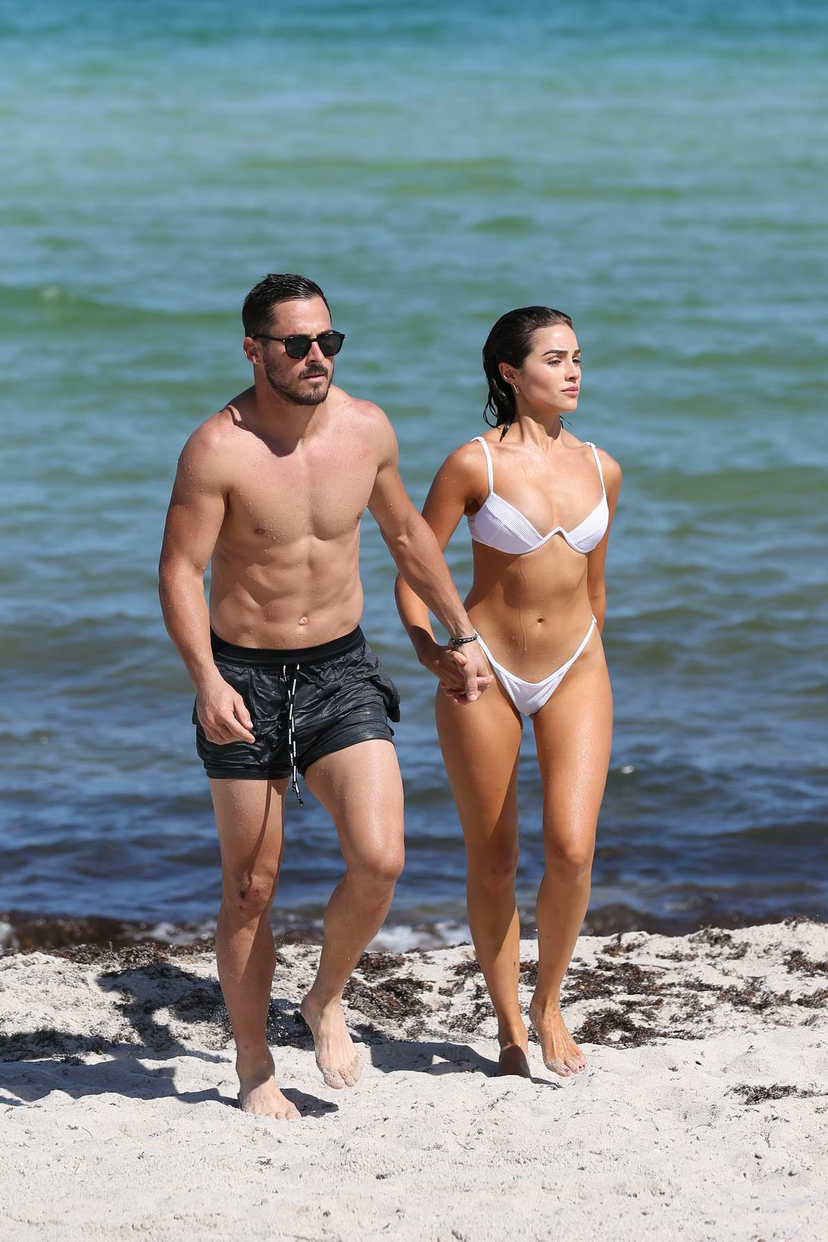Olivia Culpo rocks a white bikini while enjoying the beach with boyfriend Danny Amendola in Miami, Florida