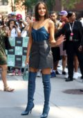 Olivia Culpo wears a blue silk top and mini skirt with blue thigh-high Fendi boots while promoting upcoming series 'Model Squad' in New York City