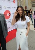 Olivia Munn steps out in all white ensemble while greeting her fans during the Toronto International Film Festival (TIFF 2018) in Toronto, Canada