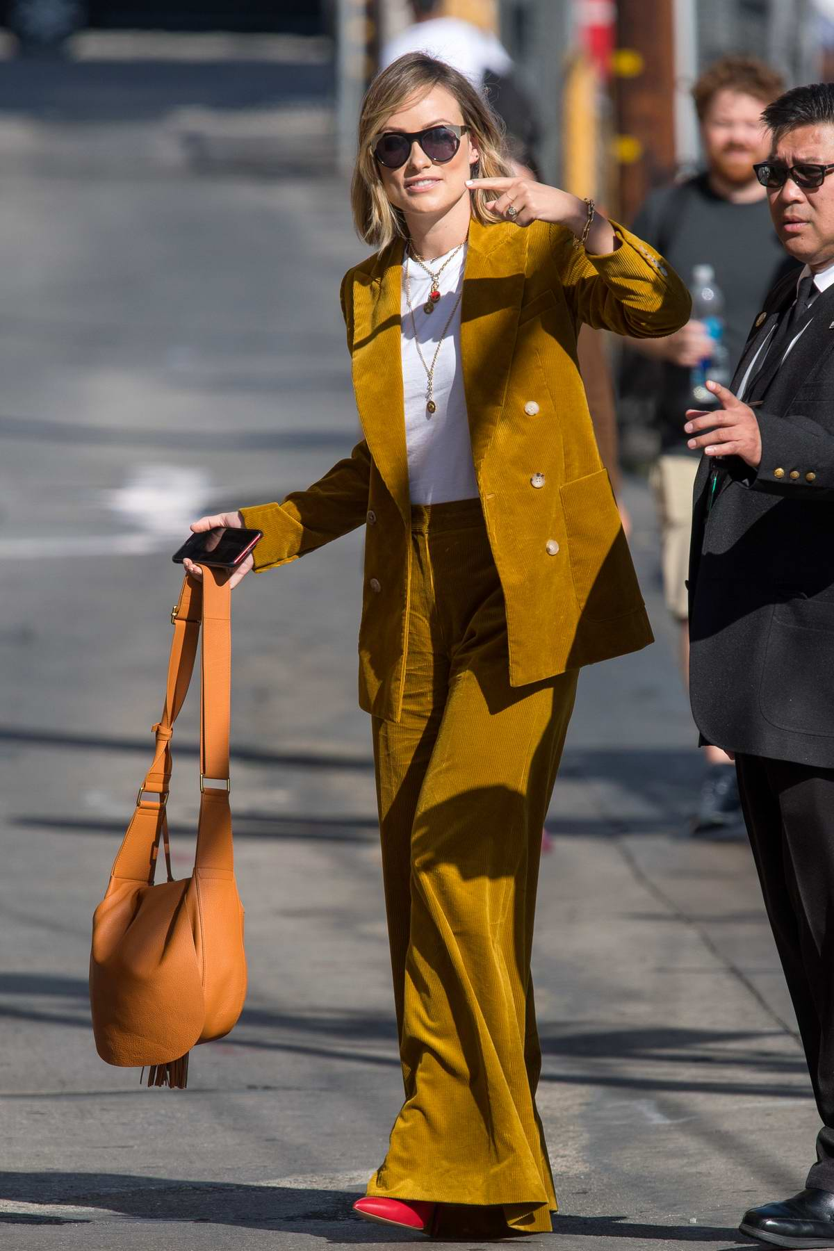 Olivia Wilde wears a mustard yellow corduroy suit as she arrives at 'Jimmy Kimmel Live' in Los Angeles