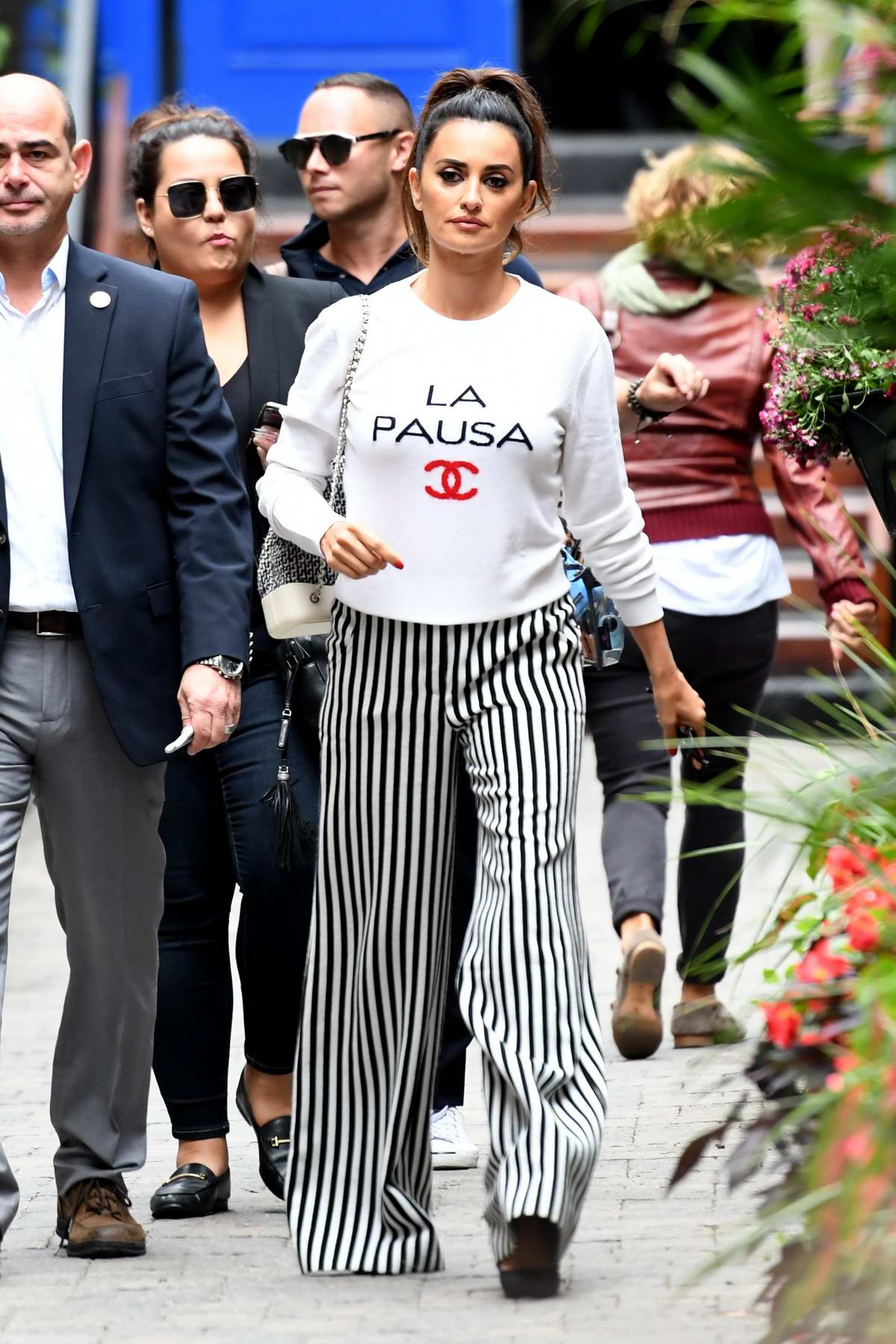 Penelope Cruz Seen Wearing Chanel Sweatshirt And Striped Pants While