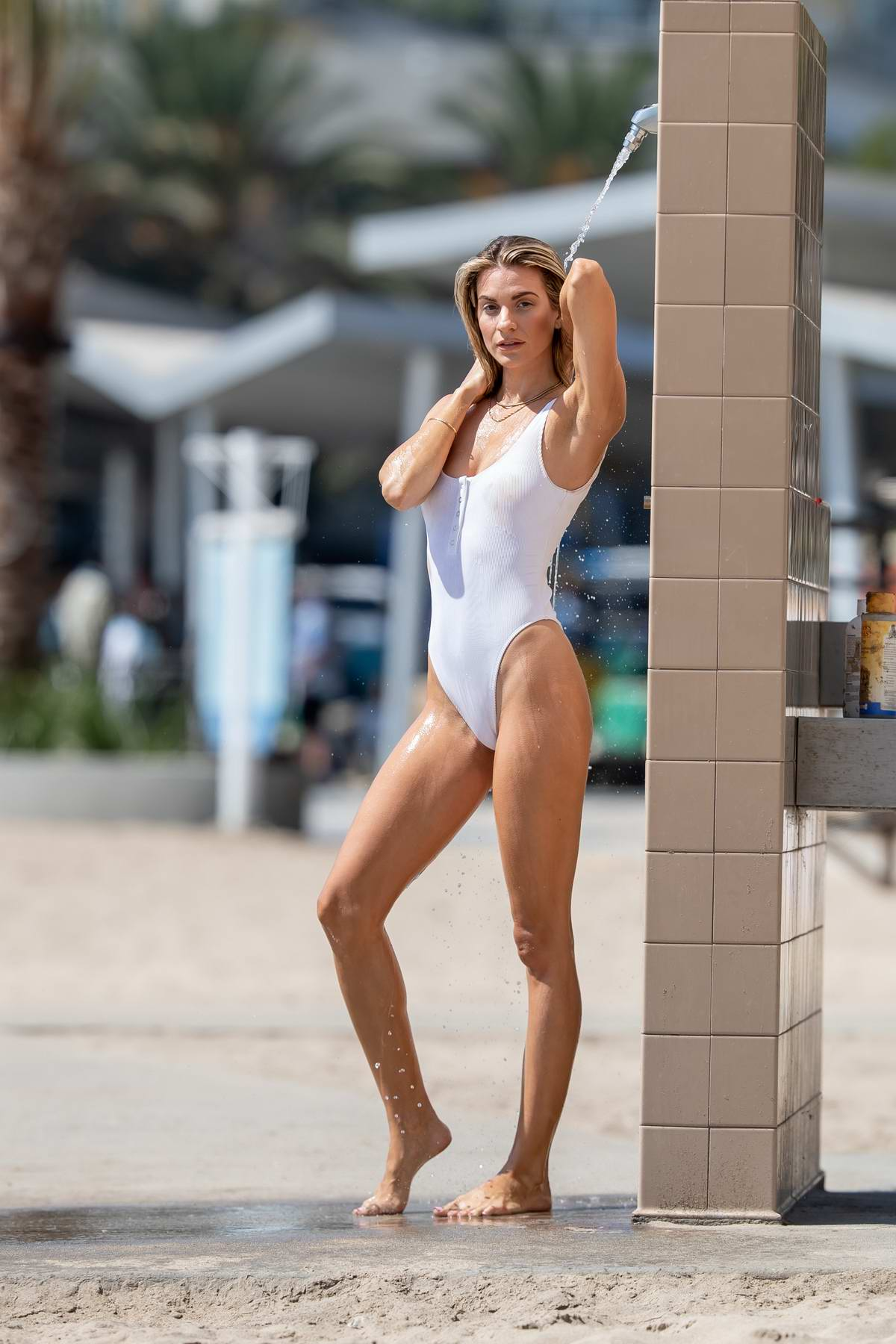Rachel McCord looks stunning in a white swimsuit as she enjoys a day at the beach in Santa Monica, California