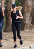 Reese Witherspoon enjoys a morning jog with a friend in Los Angeles