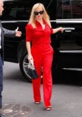 Reese Witherspoon stands out in a bright red ensemble as she visits Good Morning America in New York City