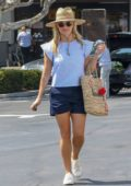 Reese Witherspoon steps out in light blue top and blue shorts as she picked up some flowers and other supplies at Gelsons Supermarket in the Pacific Palisades, Los Angeles