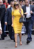 Reese Witherspoon wearing a yellow dress as she arrives at Good Morning America Studios in New York City