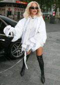 Rita Ora seen wearing a short white outfit with thigh high black boots as she arrives at Capital FM Radio Station in London, UK