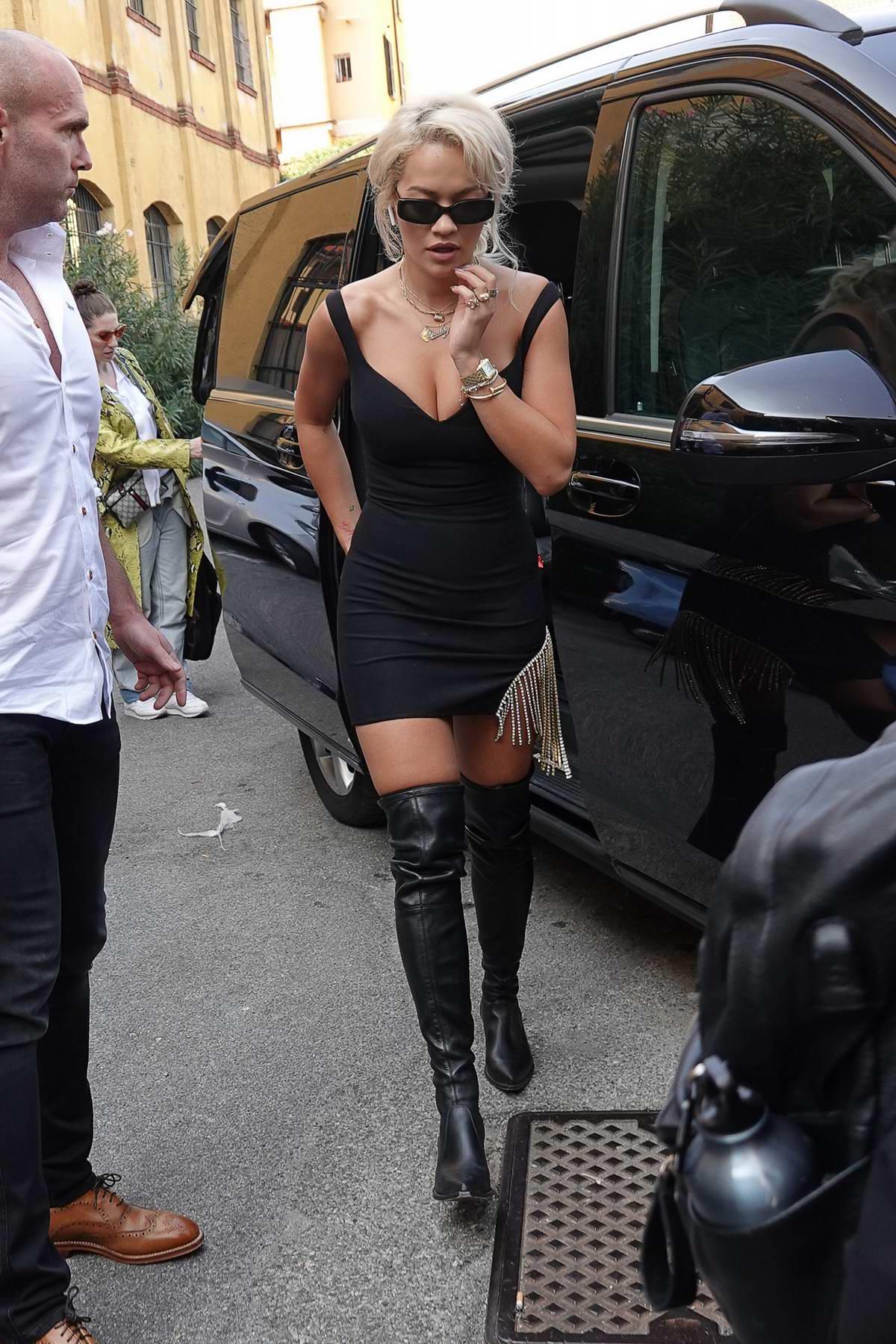 Rita Ora steps out in a black mini dress during Milan Fashion Week in Milan, Italy