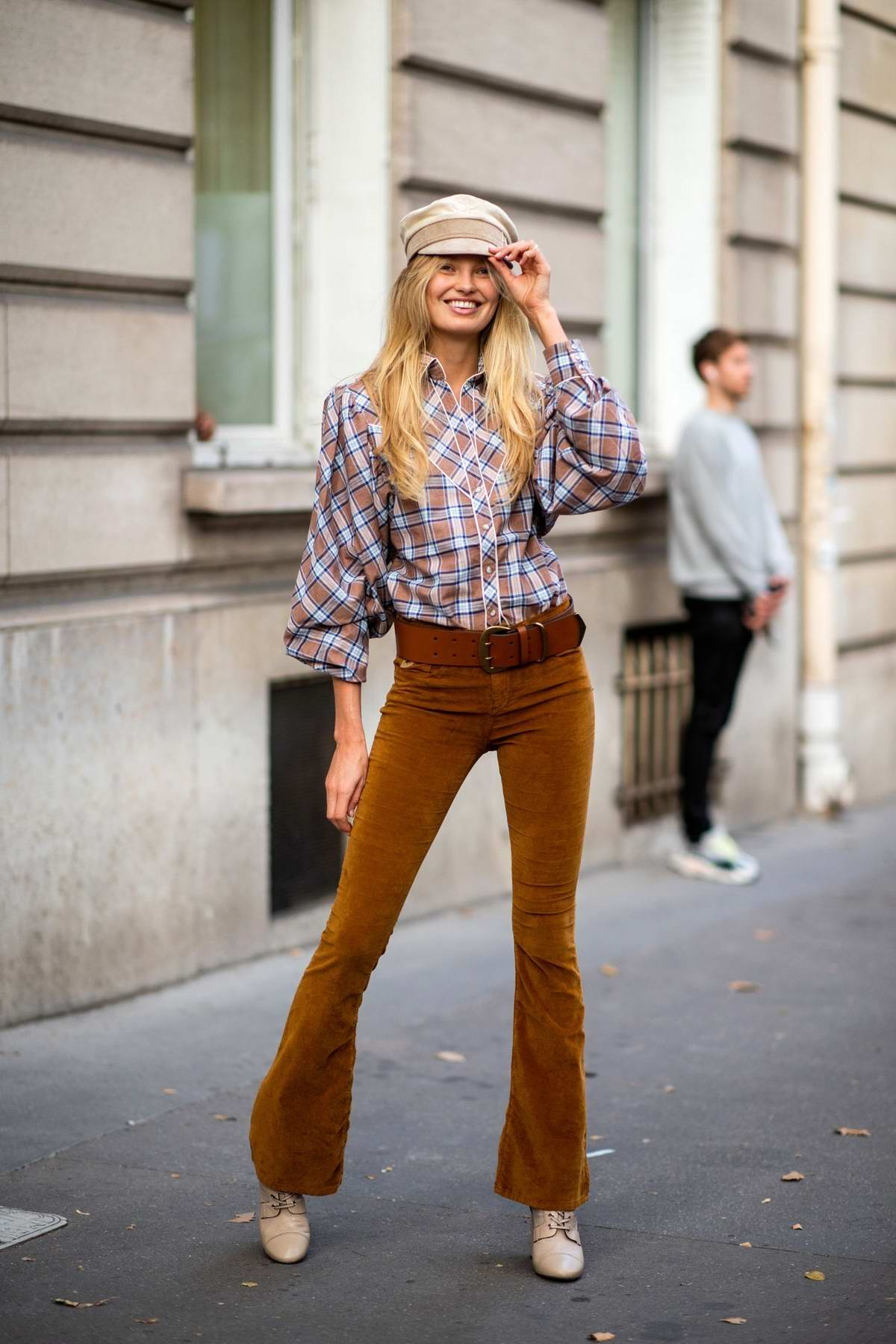 Romee Strijd steps out in a plaid shirt with flared brown jeans during Paris Fashion Week in Paris, France