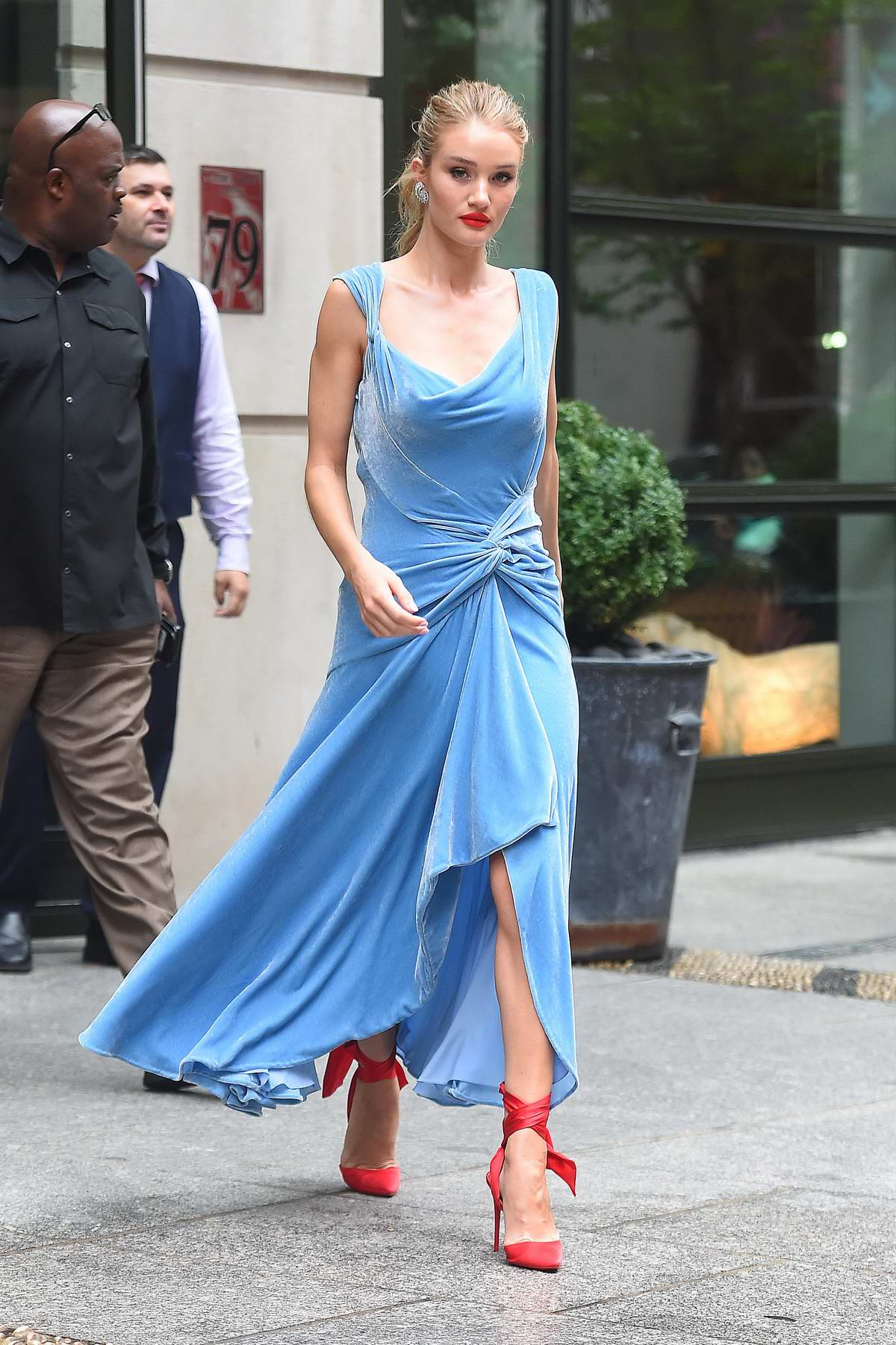 Rosie Huntington-Whiteley looks lovely in a blue dress with red heels as she heads out in New York City