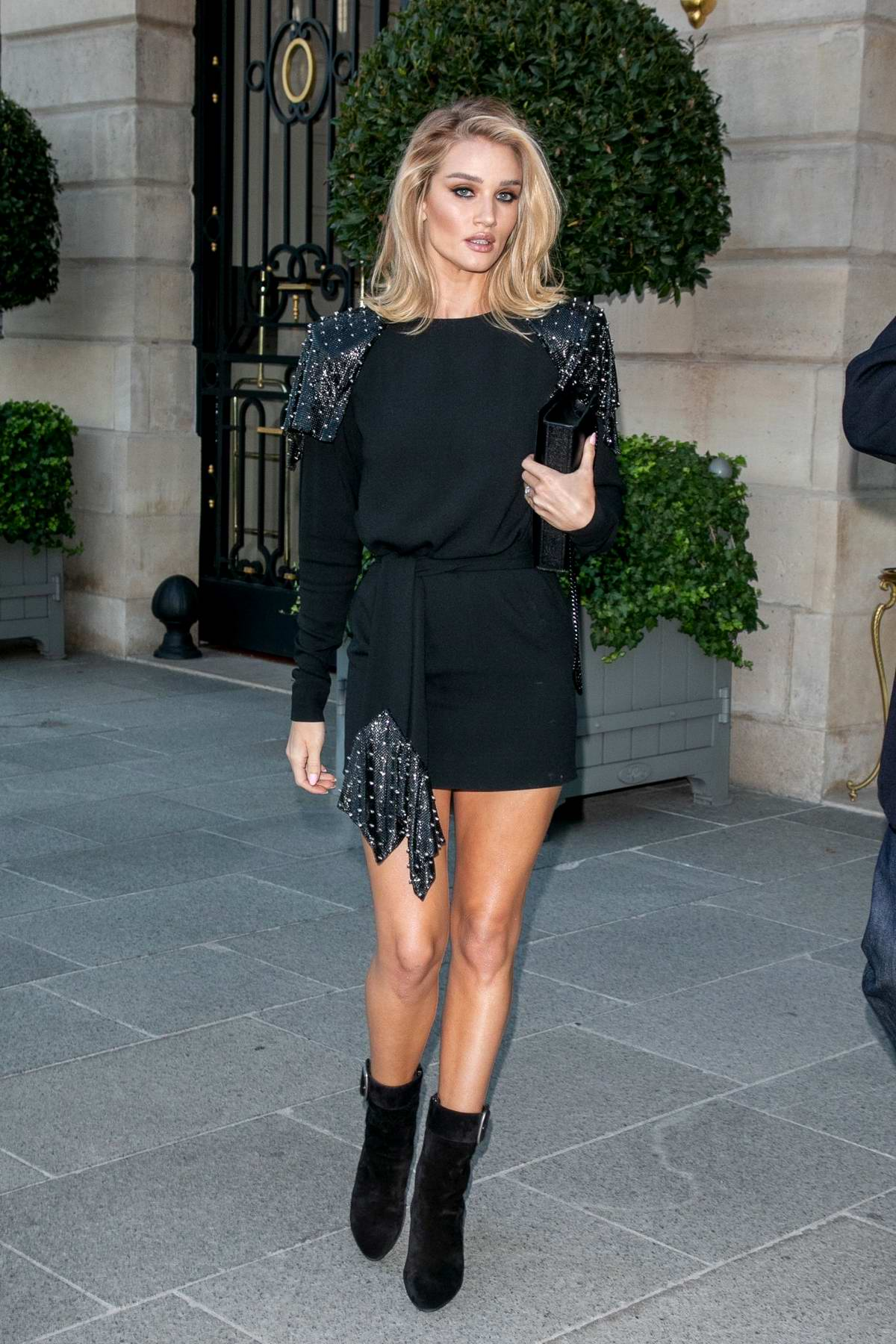 Rosie Huntington-Whiteley looks stunning in a short black dress as she leaves The Ritz Hotel in Paris, France