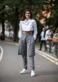 Sara Sampaio looks chic in white and grey while out during Milan Fashion Week in Milan, Italy