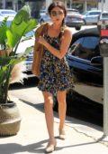 Sarah Hyland wears a printed summer dress as she runs errands in Los Angeles