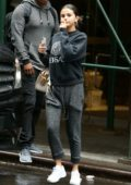 Selena Gomez wears a grey Versace sweatshirt with matching sweatpants as she steps out to grab some iced coffee in New York City