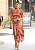 Shay Mitchell looks stylish in a coral orange dress while heading out in New York City