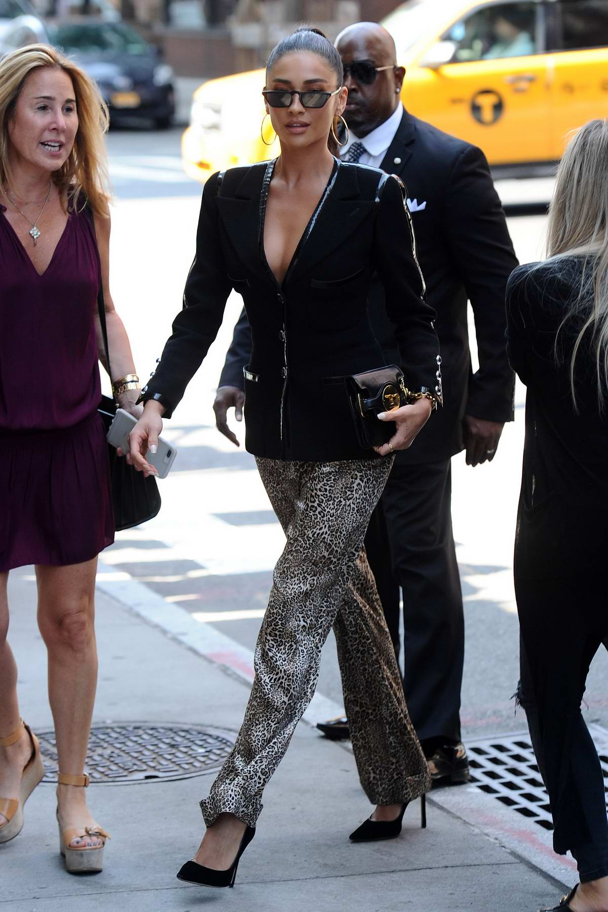 Shay Mitchell rocks black blazer with leopard print trousers at the AOL Build Series in New York City