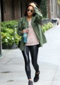 Shay Mitchell steps out in black tights and green shirt in New York City
