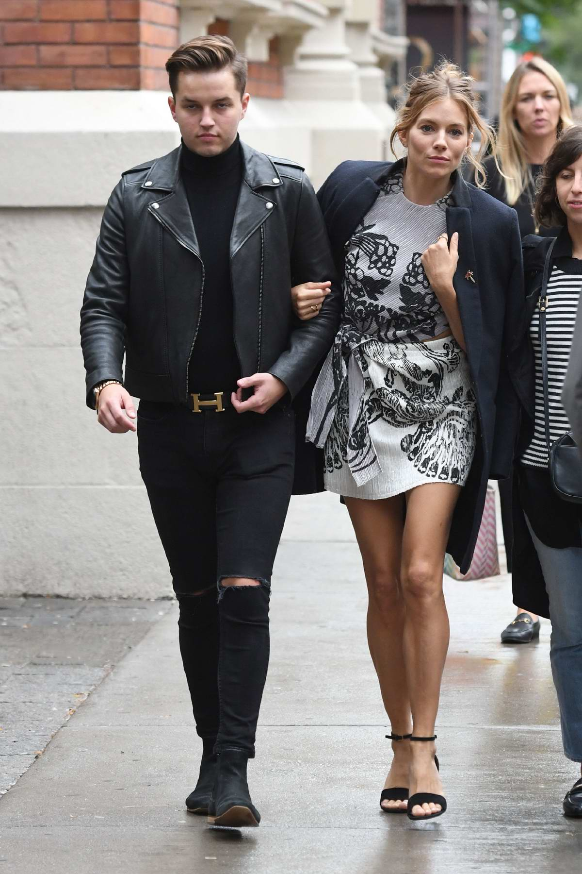Sienna Miller enjoys a stroll with a friend during during the Toronto International Film Festival (TIFF 2018) in Toronto, Canada
