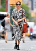Sienna Miller is seen out in a monochrome plaid dress while carrying an umbrella in New York City