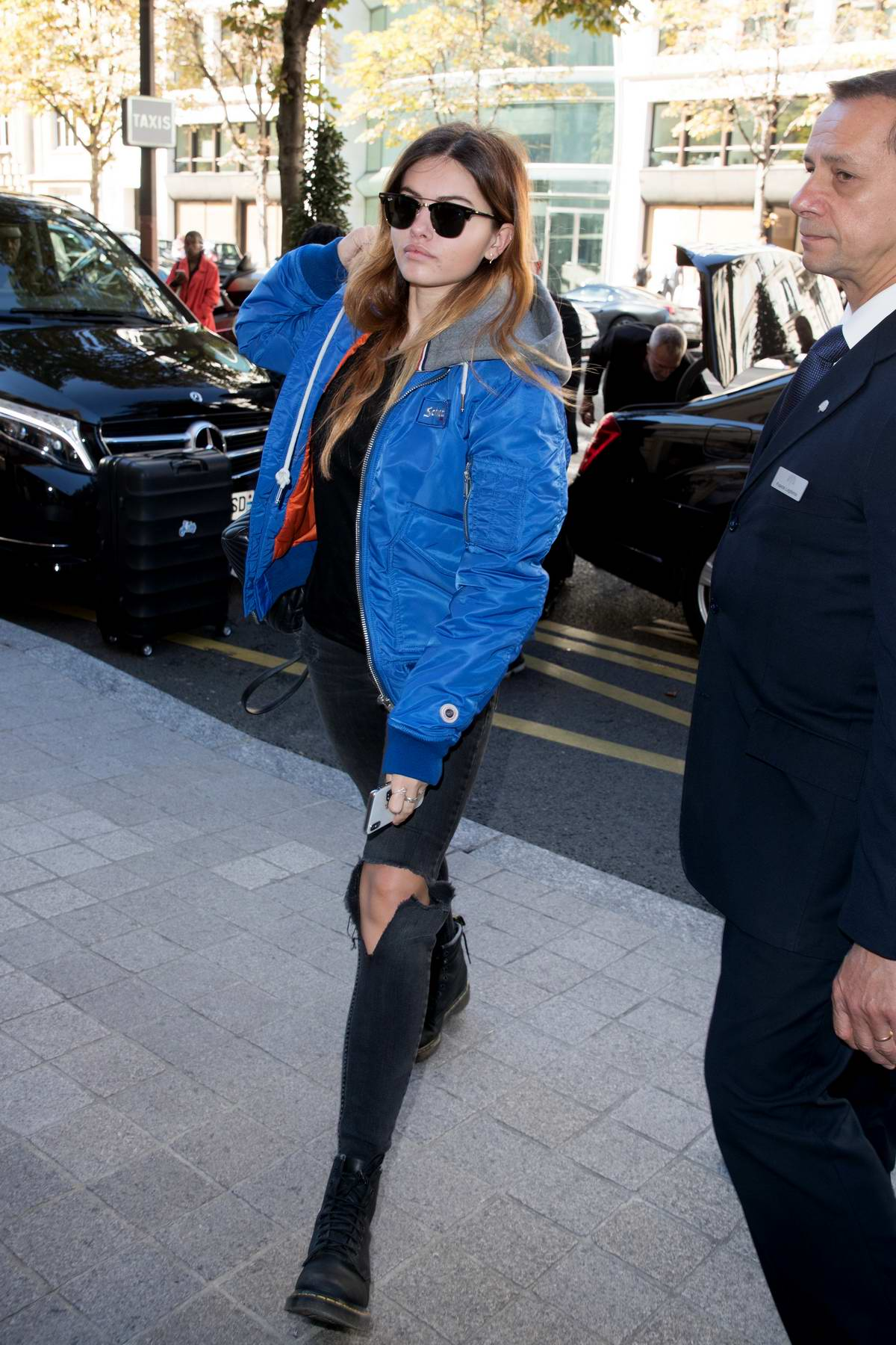 Thylane Blondeau spotted in a blue jacket and ripped jeans as she arrives at the Royal Monceau Hotel in Paris, France