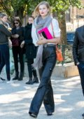 Toni Garrn steps out in a white shirt and black leather pants in Paris, France
