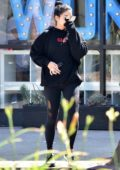 Vanessa Hudgens covers her face while heading to the Pilates class in a black sweatshirt and leggings in Studio City, Los Angeles
