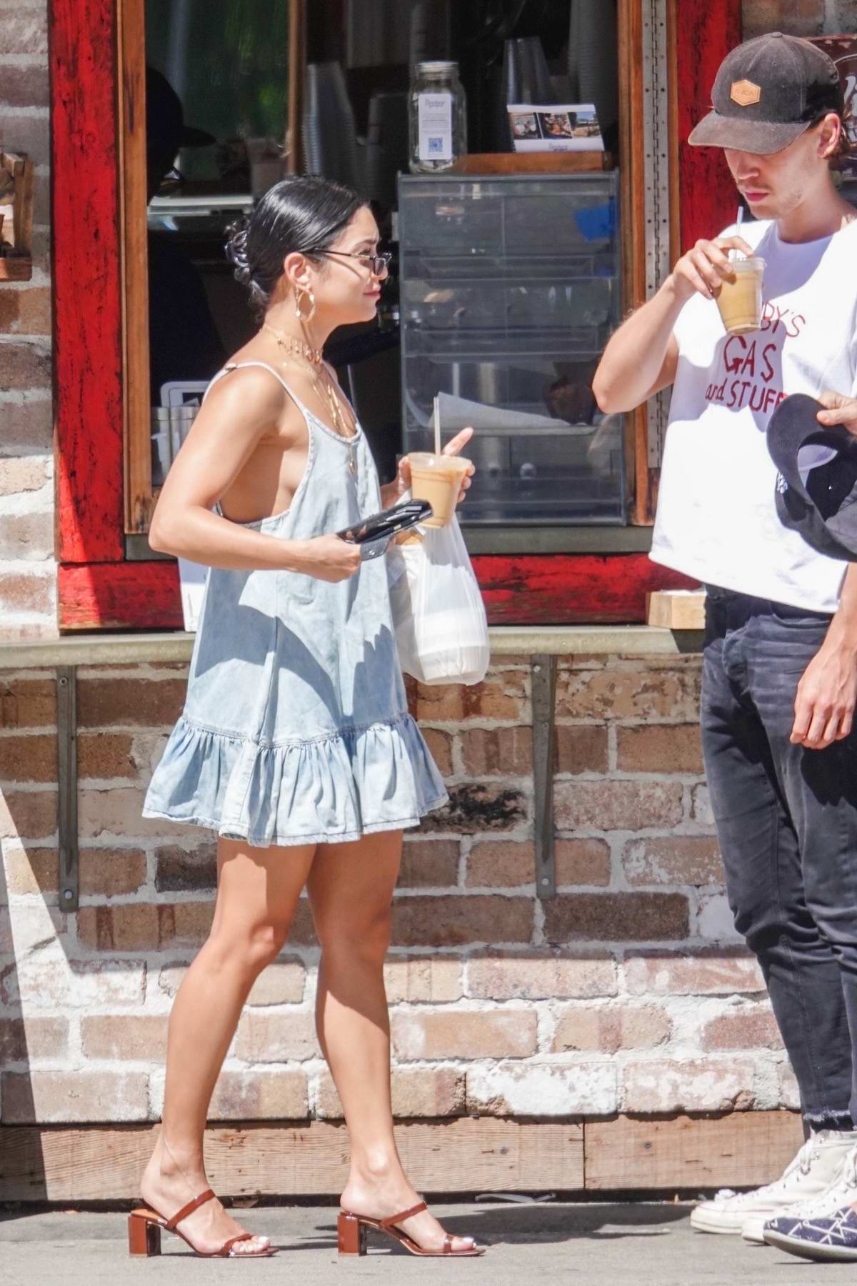 Vanessa Hudgens looks cute in a blue sundress as she and boyfriend Austin Butler grabs some coffee and snacks in Los Angeles