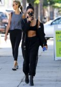 Vanessa Hudgens shows off her toned midriff while out in all black workout gear in Los Angeles