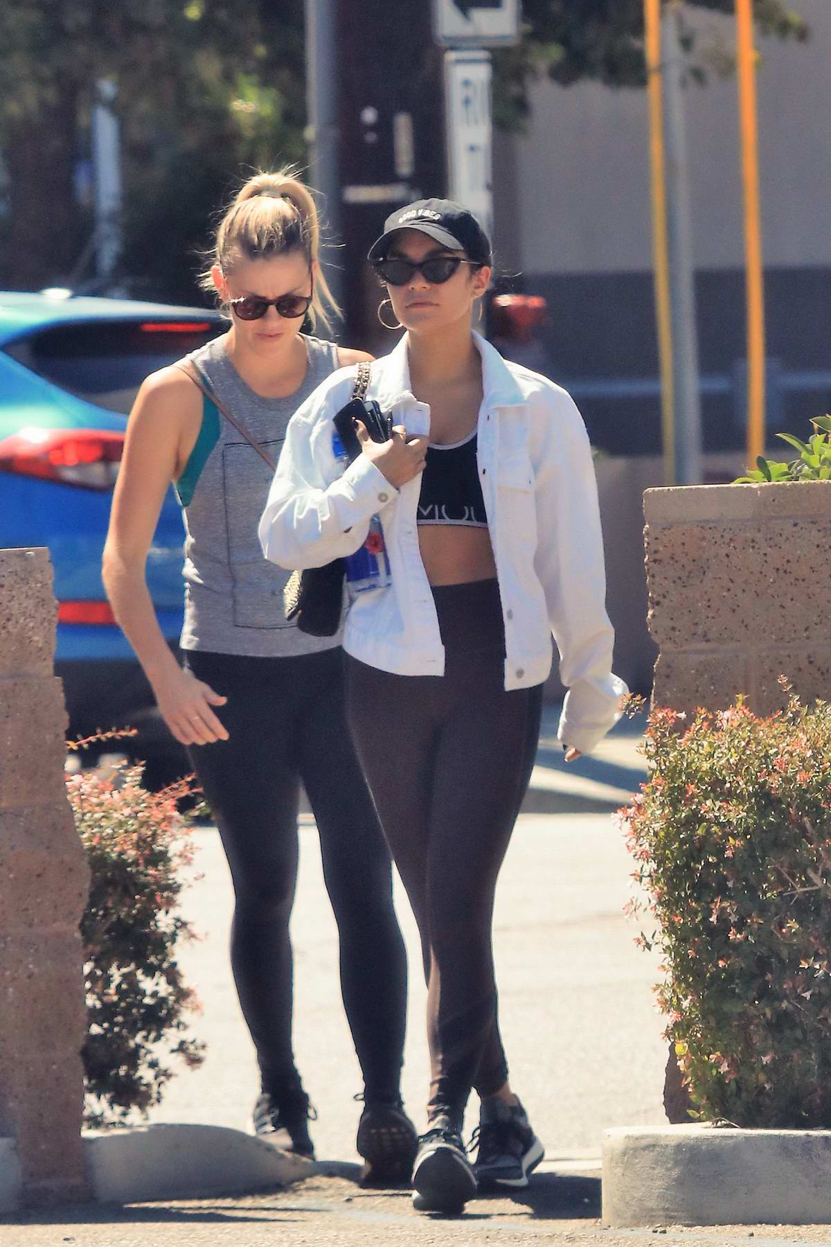 Vanessa Hudgens spotted in a denim jacket over her workout gear as she heads to the gym with a friend in Los Angeles