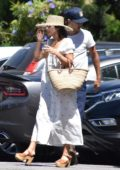 Vanessa Hudgens wears a white summer dress with sunhat while out with beau Austin Butler in Studio City, Los Angeles