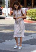 Zoey Deutch steps out in white patterned dress while running errands in New York City