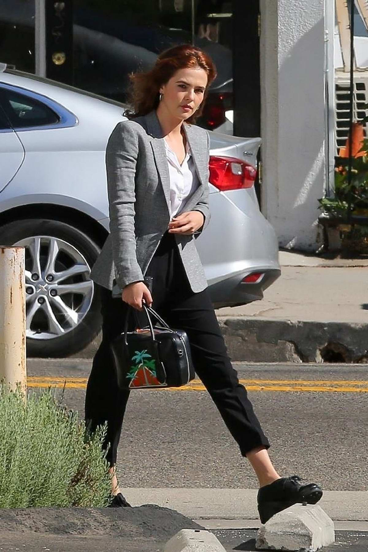 Zoey Deutch Wears A Grey Blazer And Cropped Black Pants As She