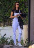 Alessandra Ambrosio says a quick goodbye to her son as she leaves for the LAX airport in Los Angeles