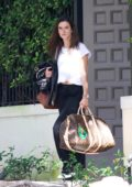 Alessandra Ambrosio steps out without makeup while carrying a Louis Vuitton travel bag as she leaves her house in Brentwood, Los Angeles