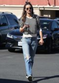 Alessandra Ambrosio wears a striped sweatshirt and ripped jeans while heading to a skin care clinic in Encino, Los Angeles