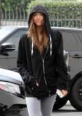 Alexis Ren wears a black hoodie and grey leggings as she arrives at 'Dancing With The Stars' rehearsal studio in Los Angeles